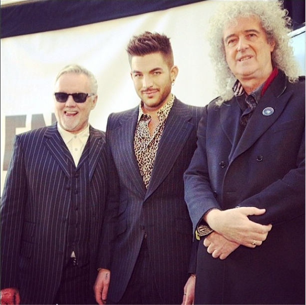 Adam Lambert looks so cute with his tourmates, Queen.